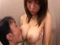 Enticing Asian maid has a horny guy licking her huge natura