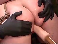 Tied up lesbo gets dildoed and fingered