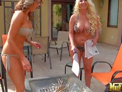 Molly Cavalli and Courtney Cummz show off their big tits by the pool