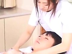 Petite Asian chick has a masseuse working her hands on her
