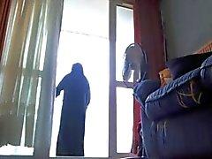 på min balkong i niqab