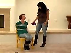 Woman duct taped by woman