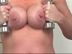 Busty brunette uses massive dildo to cum at gym