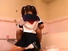 Asian schoolgirl with pigtails works her skillful hands on