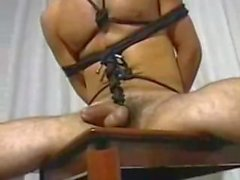 Guto tied to chair