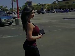 Denise Milani walking down the street