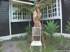 Blonde shemale hottie jerking off while outdoors