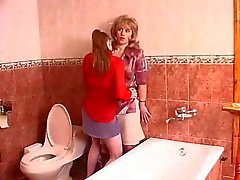 Mature pussy licking in a toilet