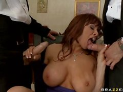 Big boobed MILF handles two big dicks at once