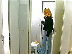 Monika Goes In A Public Toilet Booth To Masturbate