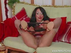 Ebony babe Kayla Louise fucks her christmas vibrator on the couch in ff nylons