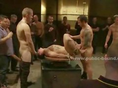 Man undressed and humiliated in tough gay group sex with sado maso masters