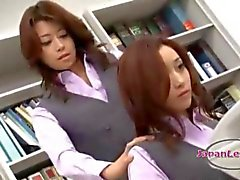 2 Office Ladies Kissing Patting On The Couch In The Office