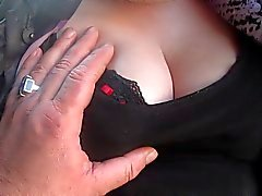 Touching her stockings and tits in a bus