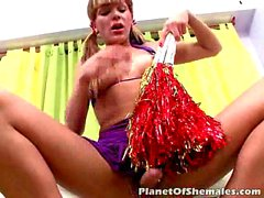 Cheeky shemale cheerleader in pigtails Melina dancing and