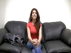 Sexy young brunette is on the official casting couch and wants a job in fucking