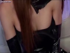 Asian shemale in latex gets rubbed