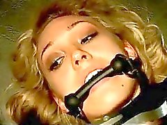 Blonde Girl With Mouthgag Legs And Arms Tied Up Pussy Fingered And Fucked Getting Buttplug Tortured With Stick By Master In The Dungeon