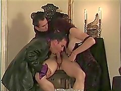 Hot stud gets his cock sucked by chick and dude in chair then fucks