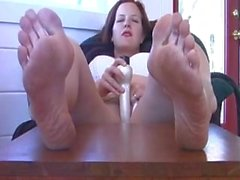 Kinky milf annabelle shows off her soles while fucking herself