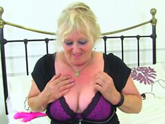 Granny Claire Knight works old pussy with fingers and dildo