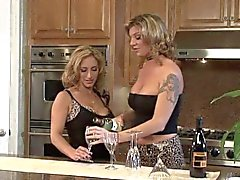 Lesbian threesome on the kitchen counter