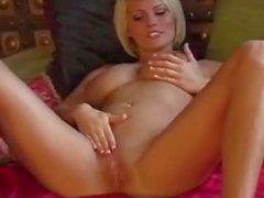 Bid titties plays with her toy