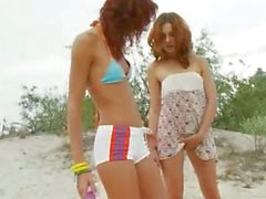 american teens toying on the beach