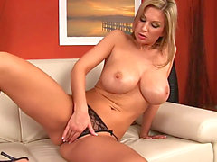 buxom Carol oils Herself Up and Gets Off