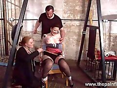 Submissive Caroline Pierces spanking and double domination of plastic tied