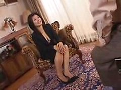 Attractive Oriental housewife displays her sexy legs and bi