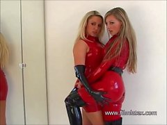 'Dancing latex lesbians Dannii Harwood and Tanyas kinky fetish games in red'